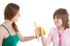 Free The Two Young Girls With A Banana Isolated Royalty Free Stock Photography - 4848197