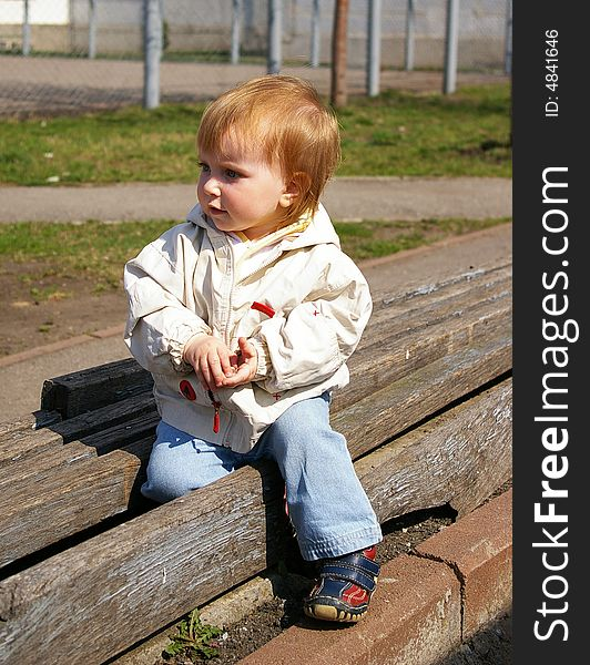 Girl sits on the bench