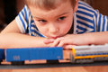 Free Boy Looks At Toy Railroad Stock Photo - 4858050