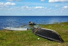 Three Old Wooden Boats On The Lake Bank Royalty Free Stock Image