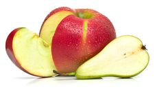 Green Pear And Ripe Red Apple Royalty Free Stock Photos