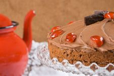 Free Chocolate Cake With A Red Tea Pot Royalty Free Stock Photography - 4854467