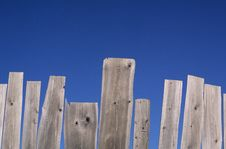 Weathered Fence And Blue Sky Royalty Free Stock Photo