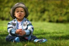 Free Sad Boy  Sitting On The Grass Stock Photos - 4857123