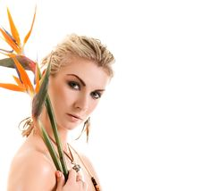 Free Sexy Blond Woman With Strelizia Flowers Isolated Stock Photo - 4857630