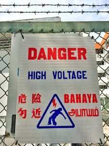 Free Danger High Voltage Sign In Four Official Languages In Singapore Royalty Free Stock Images - 48572999