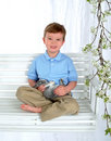 Free Boy And Bunny On Swing Royalty Free Stock Photo - 4864835