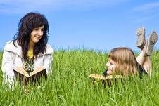 Free Couple Of Friends Enjoying A Book Stock Photos - 4860563