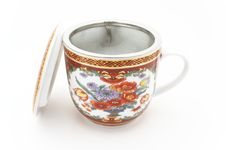 Tea Cup With Strainer Royalty Free Stock Photo