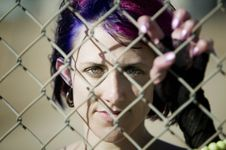 Free Woman Behind Chain Link Royalty Free Stock Photos - 4863068