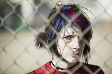 Free Punk Girl Behind Chain Link Royalty Free Stock Images - 4863069