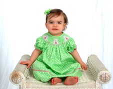Free Baby Girl In Green On Bench Stock Images - 4864184