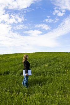 Young Woman With Laptop In Meadow Royalty Free Stock Photos