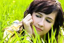 Free Pensive Beauty On Grass Stock Photography - 4865292