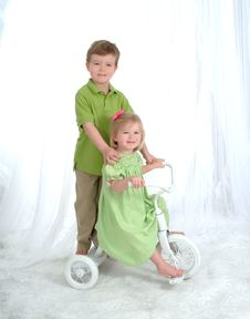Free Siblings On Tricycle Royalty Free Stock Photo - 4865355
