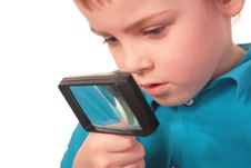 Free Boy Looks Through  Magnifier Stock Photo - 4865540