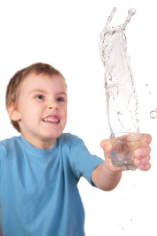 Free Boy Spills Water From Glass Royalty Free Stock Image - 4865626