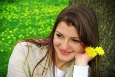 A Girl With Yellow Flowers Royalty Free Stock Image