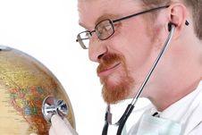 Doctor Examine A Globe Stock Photo