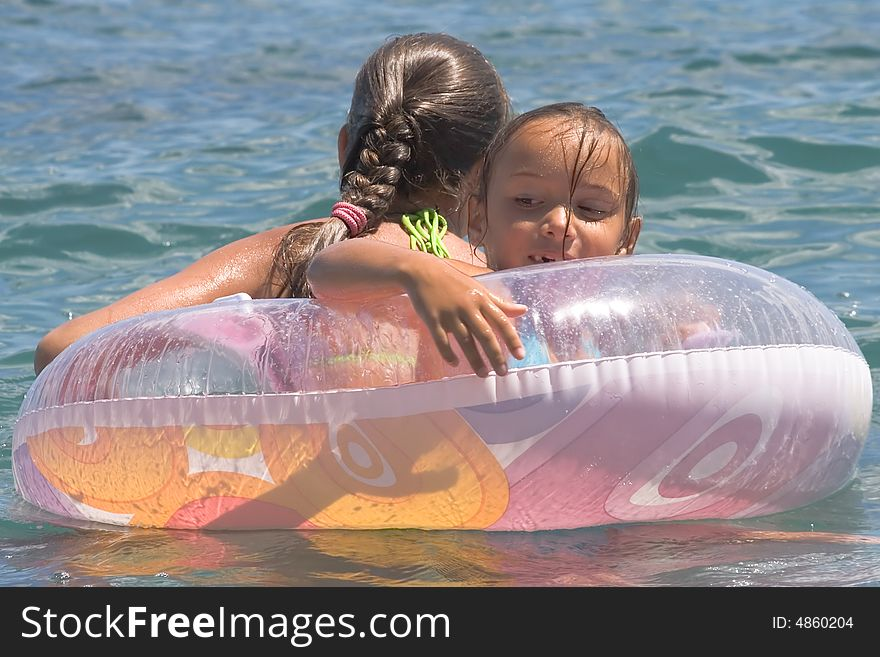Two girls of teenager bath in a sea (10)