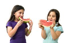 Free Two Girls Eating Watermelon Royalty Free Stock Images - 4871829