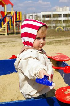 Free Girl Plays Sand Stock Photo - 4874420