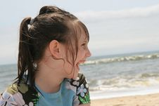 Young Girl Laughing On The Beach Royalty Free Stock Photo