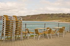 Free Stacked Chairs By The Beach Stock Photos - 4878153
