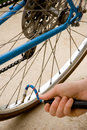 Free Inflating The Tire Of A Bicycle Stock Photo - 4885570