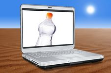 Free Laptop Computer With Water Bottle Stock Photography - 4884972