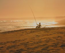 Free Woman Sitting With Fishing Rod On Beach Royalty Free Stock Photos - 4885028