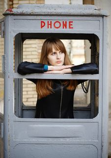 Free Lonely Girl In Old Phonebox Royalty Free Stock Images - 4888769