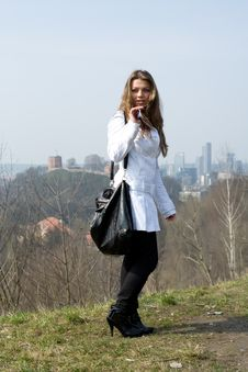 Free Girl In A White Raincoat Stock Images - 4893544