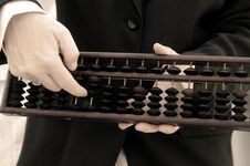 Business Hand Using A Chinese Abacus Royalty Free Stock Image