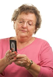 Free Senior Woman Texting On Cell Phone Stock Photos - 4894063