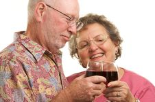 Free Happy Senior Couple Toasting Royalty Free Stock Images - 4894109