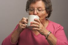 Free Senior Woman Enjoys Hot Coffee Royalty Free Stock Photos - 4894188