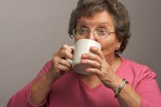 Free Senior Woman Enjoys Hot Coffee Stock Photo - 4894190