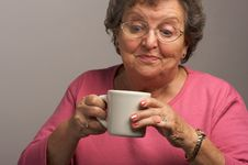 Free Senior Woman Enjoys Some Coffee Stock Photography - 4894192
