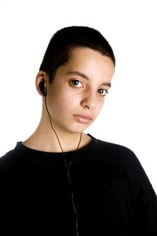 Free Teenage Boy Listens To A MP3 Player Royalty Free Stock Photos - 4899298
