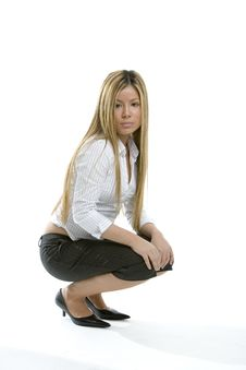 Free Pretty Girl Crouching Royalty Free Stock Image - 493436