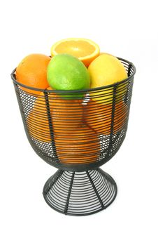 Citrus Fruit In Wire Basket Royalty Free Stock Image