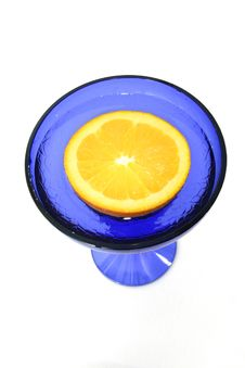 Free Half An Orange In A Blue Glass Royalty Free Stock Photo - 497775
