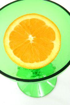 Free Orange Half In Green Glass Stock Image - 497781