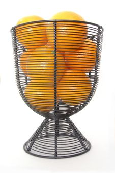 Oranges In A Wire Basket Royalty Free Stock Photography
