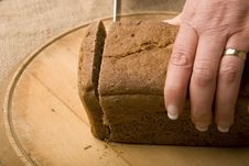 Free Woman Slicing Loaf Of Rye Bread Royalty Free Stock Photos - 4901038