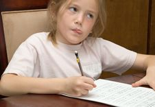 Free Thoughtful Girl Doing Homework Royalty Free Stock Photography - 4902227