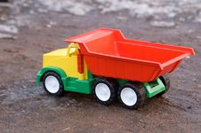 Free Baby Toy Dump Truck In Mud Stock Photos - 4903963