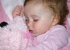 Beautiful Girl Sleeps With Her Toy Stock Images
