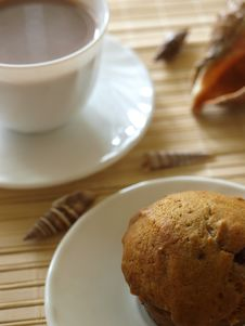Close Up Muffin With Cup Of Coffee In Background Stock Photo